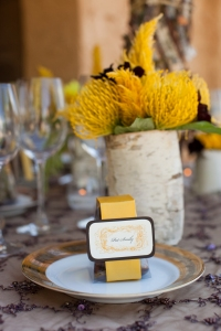 clear favor box with chocolate covered almonds, golden ribbon band and double mounted guest name card