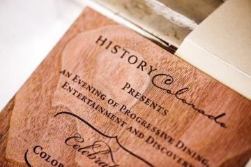 closeup of the letterpress printed black on walnut wood veneer